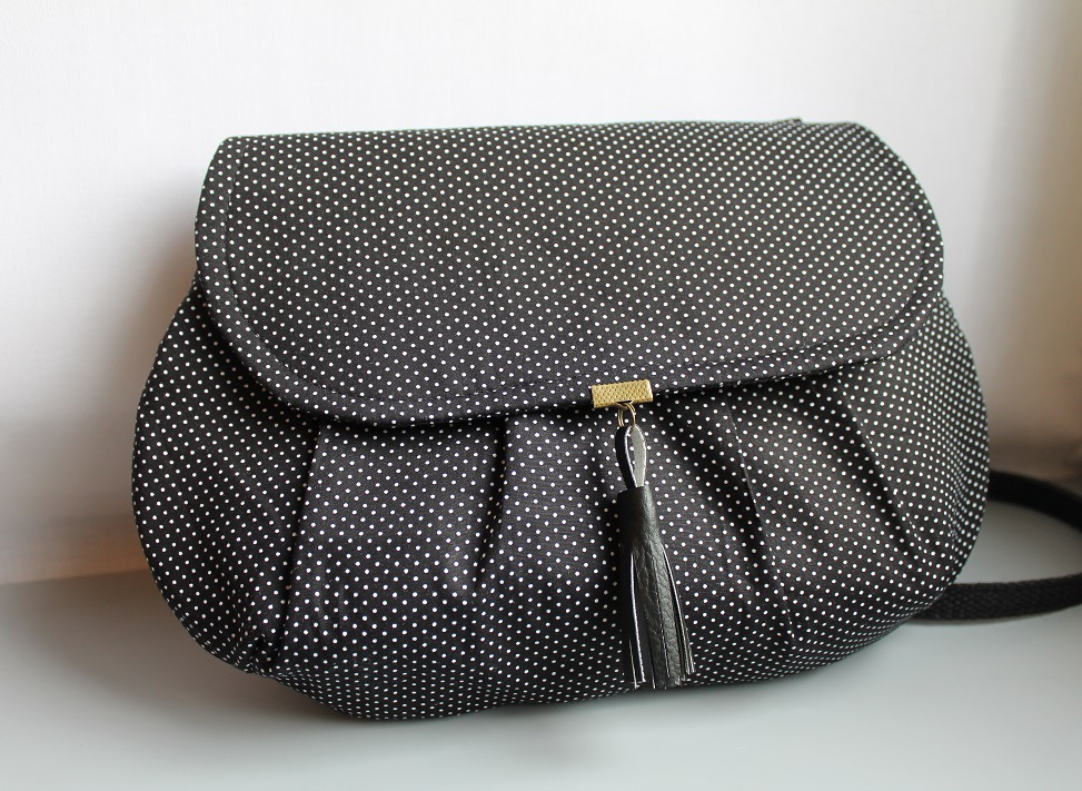 cross body clutch - black with dots